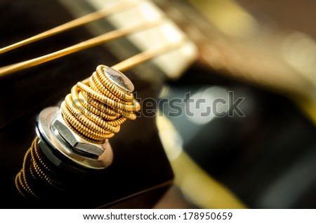 Close up detail of guitar string and blurred background - stock photo