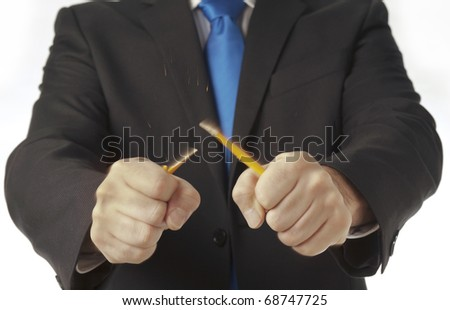 close up detail of mans hands breaking a pencil