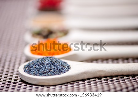 Close up detail of poppy seeds on ingredient mix - stock photo