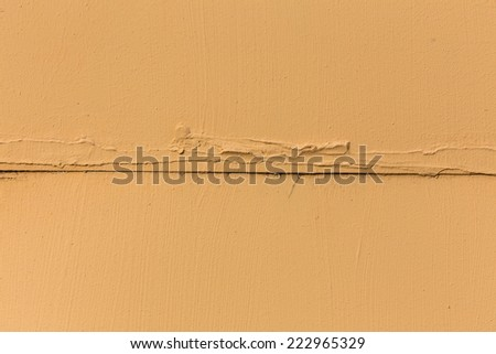 close up detail of rustic textured terracotta stucco wall - stock photo