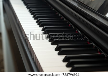 Close-up detail of the keys of electric piano keyboard. Classic style.