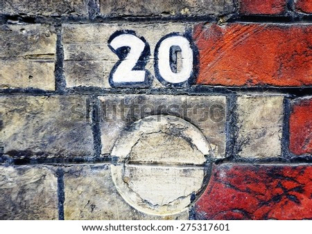 Close-up detail of the number twenty (20) on a brick wall - stock photo