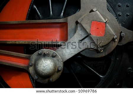 Close-up detail of the wheel of  a steam locomotive. - stock photo