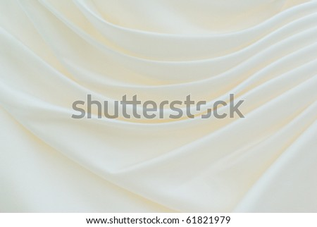 close-up detail of wedding dress pleated and draped as a nice background image - stock photo
