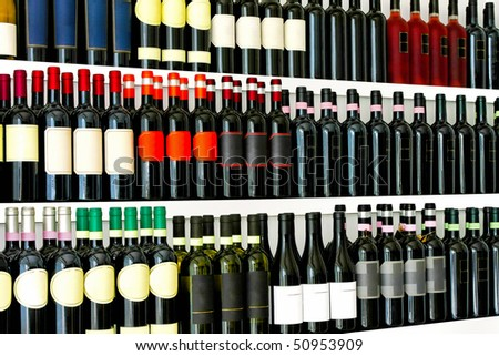 Close up detail of wine bottles shelves - stock photo