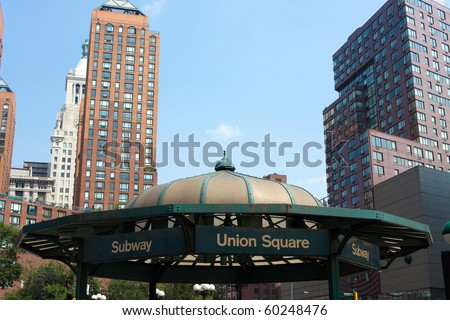 Close up detail view of the Union Square subway terminal entrance with plenty of negative space in the blue sky above it.