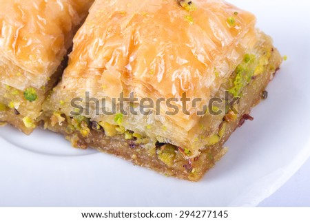 Close up detailed view of baklava with pistachio, delicious turkish dessert. - stock photo