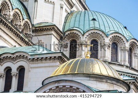 Close up detailed view of famous Bulgarian Orthodox church of Alexander Nevsky Cathedral built in 1882 in Sofia, Bulgaria, on blue sky background. - stock photo