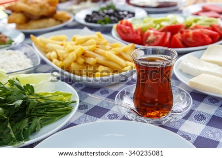Close up detailed view of Turkish style rich and delicious breakfast table. - stock photo