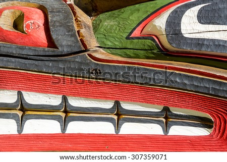 Close up detailing of ancient colorful Totem pole in Victoria, British Columbia, Canada. - stock photo