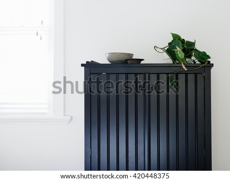 Close up details of a bedroom cupboard with ornaments with space for text - stock photo