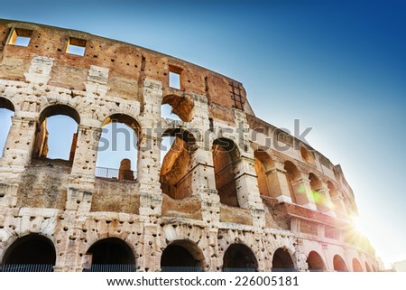 Close-up details of Colosseum with sunbeams. Rome, Italy - stock photo