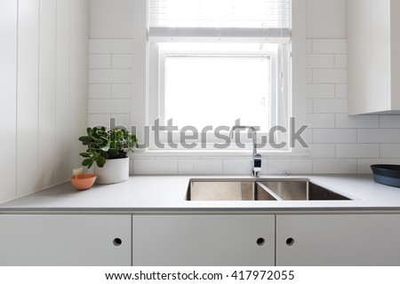 Close up details of contemporary white apartment kitchen with subway tiles - stock photo