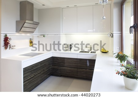 Close up details of luxurious modern fitted kitchen in home. - stock photo