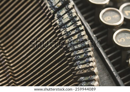 close up details of old  vintage typewriter, retro toned image - stock photo