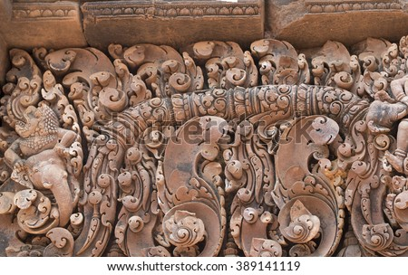 Close up details of some of the intricate pink sandstone carvings he Citadel of the Women, Banteay Srei, Cambodia, AD 987