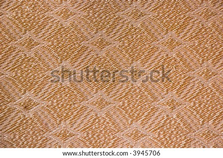 close up diamond or flower like fabric pattern in old couch material - stock photo