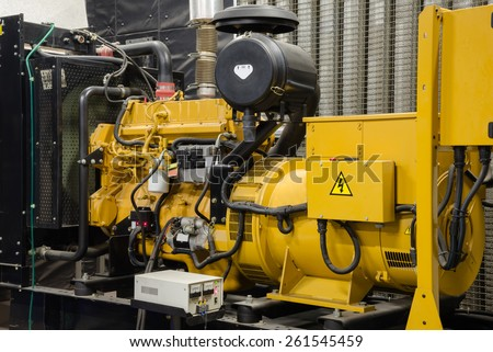 Close up diesel generator unit has a unit mounted radiator and fuel filter system. - stock photo