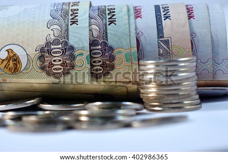 Close up different Dirhams currency note and coins, United Arab Emirates  Close up different Dirhams currency note and coins, United Arab Emirates   - stock photo