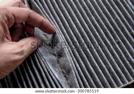 Close up dirty car air conditioner filter - stock photo