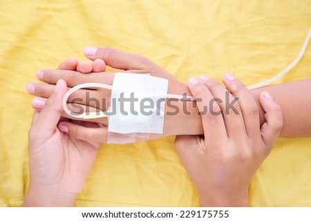 Close-up doctor holding hand of the patient ,two people holding hands for comfort. - stock photo