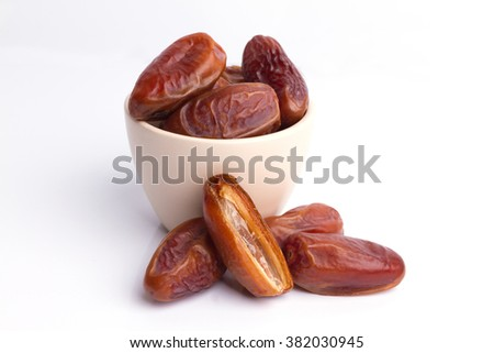 Close up Dried dates fruit on white background - stock photo