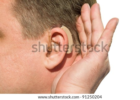 Close up ear of a man wearing hearing aid and listening for a quiet sound. - stock photo