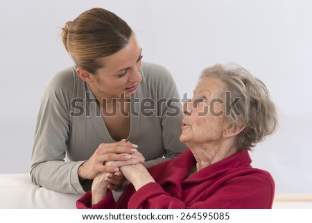 Close-up. Elderly woman and beautiful granddaughter full complicity