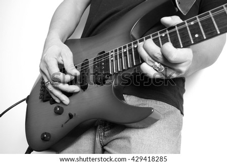 Close-up electric guitar, rock band, black and white - stock photo