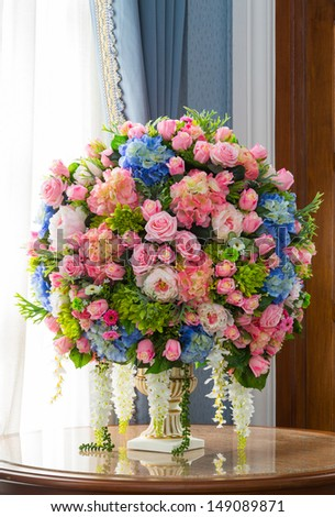 Close up elegance flower bouquet on wood table - stock photo