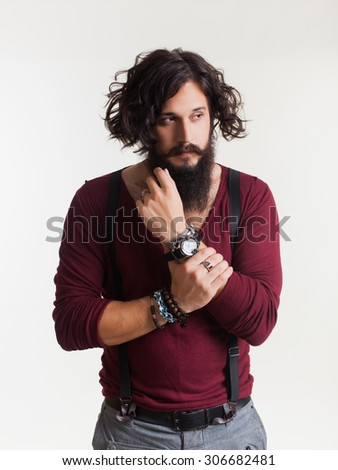 Close-up emotional and people concept:young stylish bearded man with good idea sign.Hipster style.wearing watch on his hands,barber shop,bearded man,hipster man,swagger,coat - stock photo