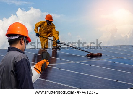 close up employee man Repair of solar cell.the concept of working,cleaning and checking on solar cell.