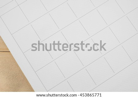 close up empty grid of calender on wood  background - stock photo