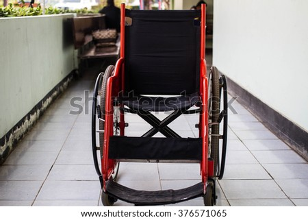 Close-up Empty wheelchair  parked in hospital - stock photo