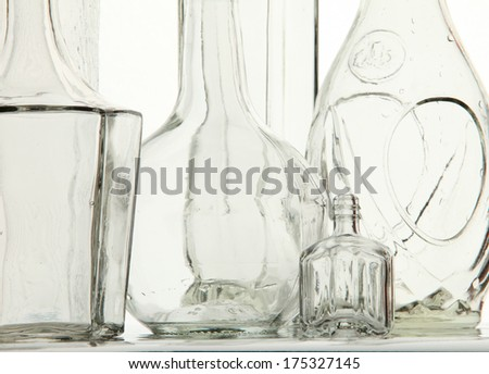 close-up empty white transparent bottle bizarre shapes on white background studio light - stock photo