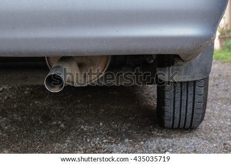 close up exhaust pipe of car. selective focus. - stock photo