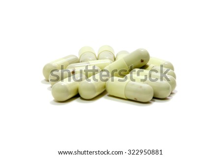 Close up expired medicine capsule isolated on a white background