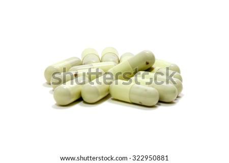 Close up expired medicine capsule isolated on a white background - stock photo
