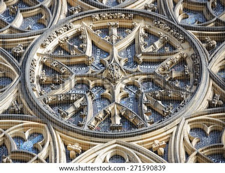 Close-up exterior view of central part of famous stained-glass Rose Window with tracery of cut stone designed by Frantisek Kusela, St. Vitus Cathedral, Prague, Czech Republic.  - stock photo