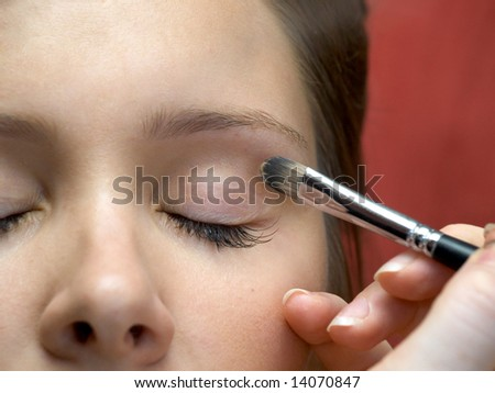 Close-up eye and brush during makeup session