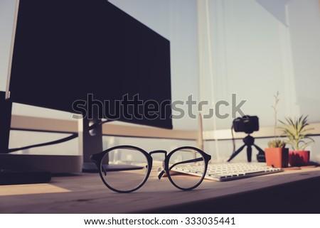 Close up eyeglasses on work desk. - stock photo