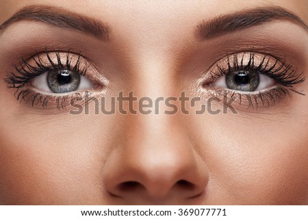 Close up eyes with perfect nude make up and good skin. Beauty and make up - stock photo