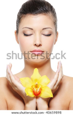 Close-up face of a beauty asian woman relaxation with flower in hands - stock photo