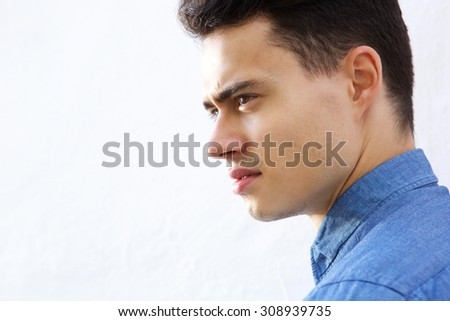 Close up face of a handsome young modern man  - stock photo