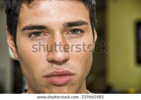 Close up Face of a Pensive Handsome Young Man with Tears on his Face, Looking at Camera, Worried or Sad. - stock photo