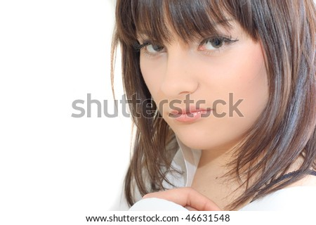 Close-up face of a young woman with brown hair - stock photo