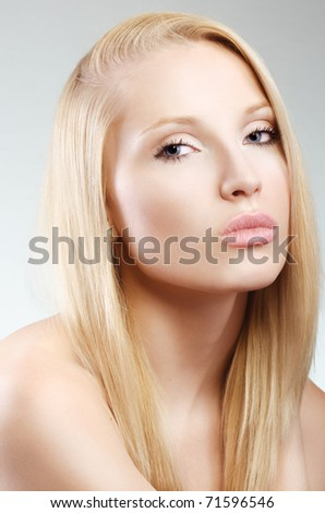 Close-up face of beautiful caucasian blonde woman with blue eyes - stock photo