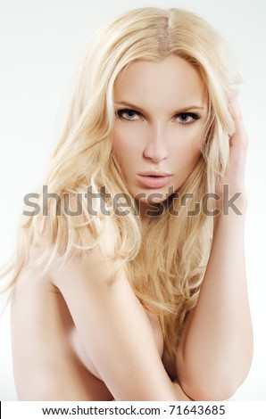 Close-up face of beautiful caucasian blonde woman with blue eyes