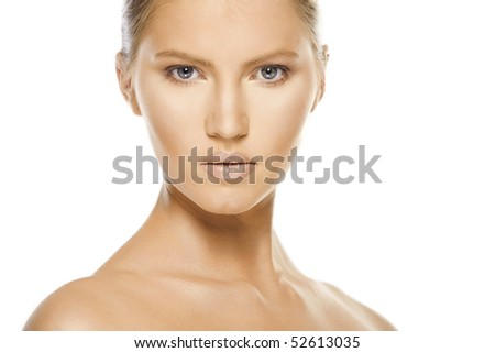 Close-up face of beautiful caucasian blonde woman with brown eyes over white - stock photo