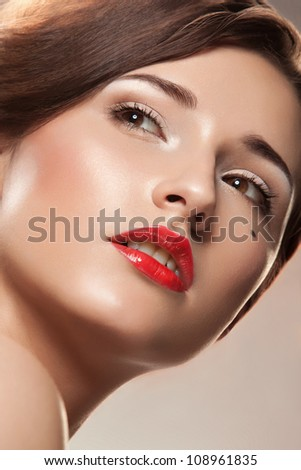 Close-up face of beautiful caucasian brunette woman with red lips - stock photo